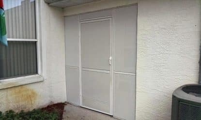 back door in brooksville, fl rescreened with white sunscreen